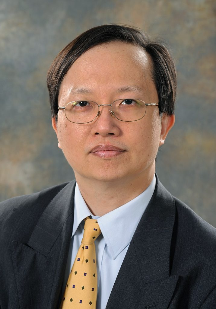 Professor Kwok-Leung Cheung smiling at the screen
