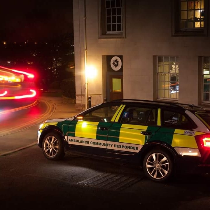Community First Responders car outside a university building at night