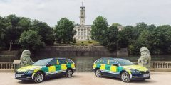 Two Community Responder vehicles in front of the lake and the Trent Building