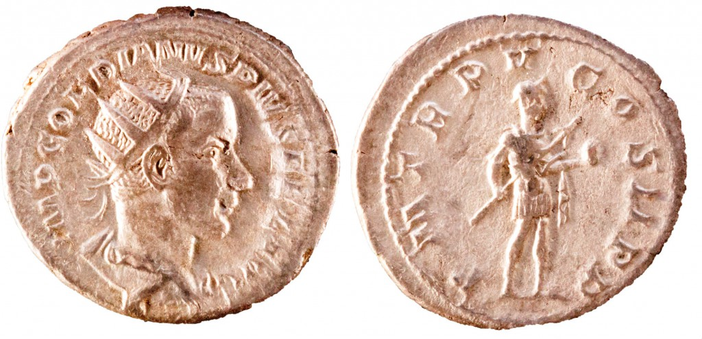 AR antoninianus of Gordian III. Obverse shows radiate, draped bust of emperor right, IMP GORDIANVS PIVS FEL AVG. Reverse has Gordian standing right in millitary clothing holding spear and globe, P M TR P V COS II PP. 4.28g, 23mm, 12 o'clock.