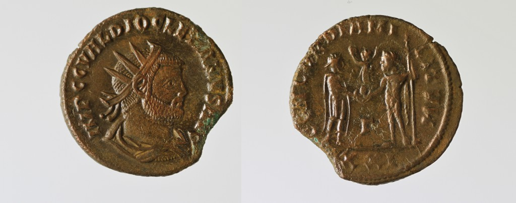 AE Follis of Diocletian. Obverse has radiate, draped bust of the emperor right, IMP CC VAL DIOCLETIANVS PF AVG. Reverse has Emperor facing right receiving Victory from Jupiter facing left holding a sceptre, CONCORDIA MILITVM / GAMMA / XXI. 20mm, 3.59g, 12 o'clock. RIC V 284v, G. Numismatic information by Rob Stone and Olivia Webster.
