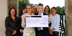 Denise Kendrick presents cheque to John Roberston with Robin Hood Way walkers