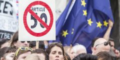 London, UK - July 2, 2016: A group of people protesting the result of the EU Referendum in the UK on on 23 June, which saw the UK vote for Brexit - a withdrawal from the EU. Here protesters hold up a sign calling for Article 50 - triggering the UK exit from the EU - not to be signed.