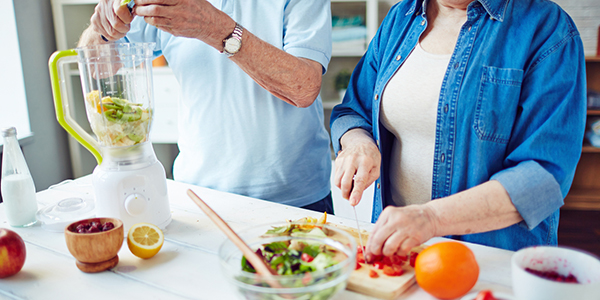 Mature couple preparing a meal together in the kitchen