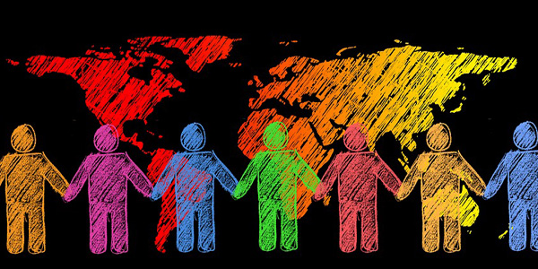 Seven Crayon Coloured Characters Holding Hands in Front of World Map