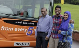 (Photoshoot 0716-017) Ismail Sadurdeen (centre) with his NCT bus.