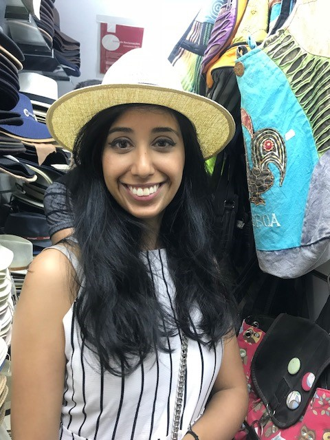 Yasmin in the one of the many hat shops in Lisbon