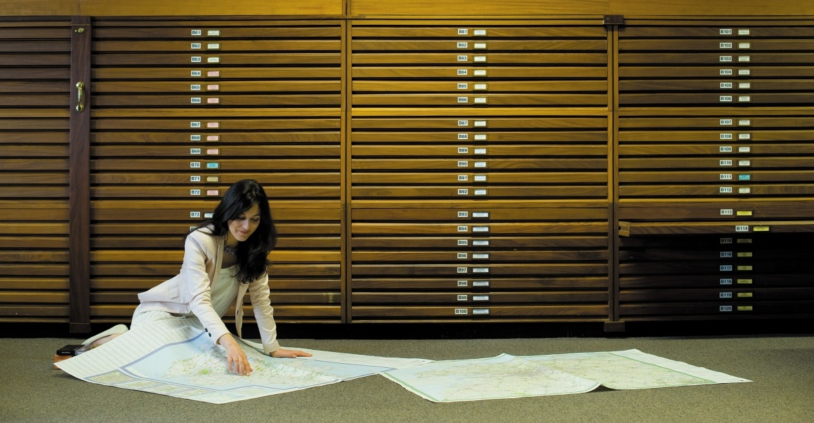 Female postgraduate student studying a map in the Edwards Resource Centre
