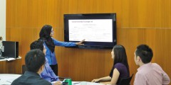 Female postgraduate student giving a presentation MBA workroom, Malaysia Campus