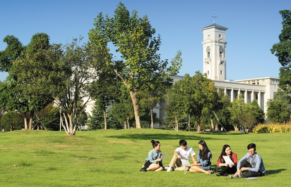 Group of undergraduate students socialising outside the Administration Building, Ningbo campus, China