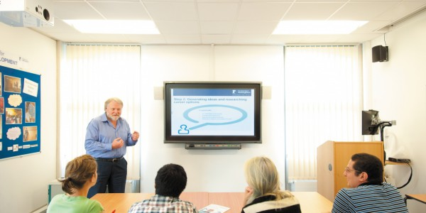 Male member of staff giving a talk in the Centre for Career Development, Portland Building