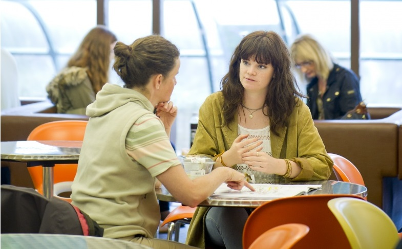 Mother and daughter sitting in Hallward Library cafe, Undergraduate Open Day - June 2014