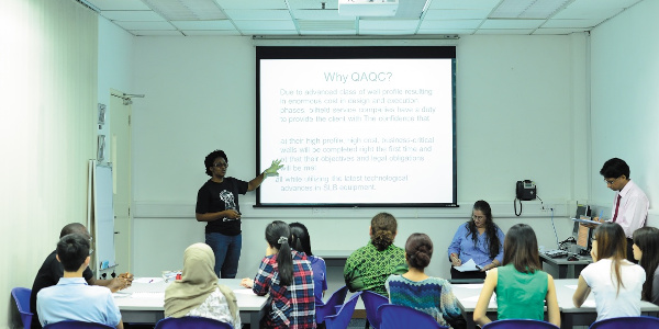 Female postgraduate student giving a presentation, Malaysia Campus
