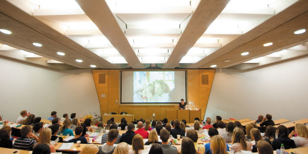 Students in lecture theatre in Dearing Building, Jubilee Campus