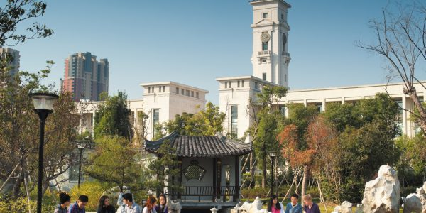 Undergraduate students relaxing in a garden opposite the Administration Building, Ningbo campus, China