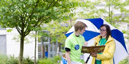 Student helper talking to a member of staff