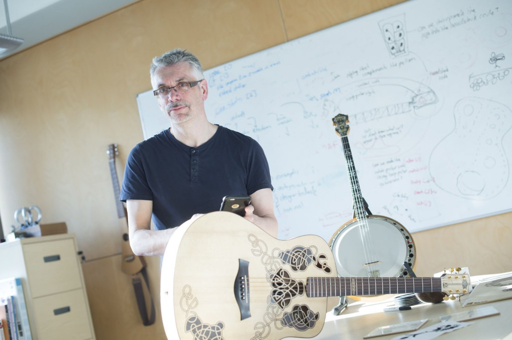 Professor Steve Benford with Carolan, an interactive acoustic guitar created in the University's Mixed Reality Lab that can digitally capture and chart its own life history.