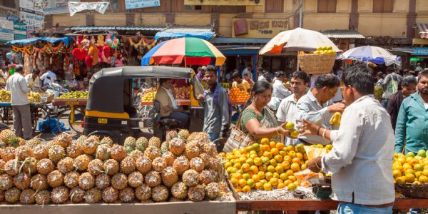 A crowd of people in a market in India