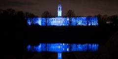 The Trent Building is lit up in blue