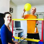 Mark and his wife, Samanta, filming an inclusive home workout