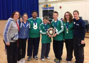 Molly receiving a gold medal for goalball, with the rest of her team.