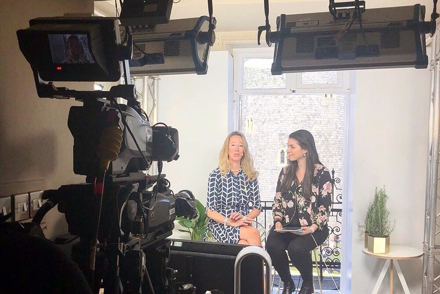 Sabrina interviewing royal wedding dress designer, Catherine Arthur, at Windsor on the day of Megan Markle and Prince Harry's wedding