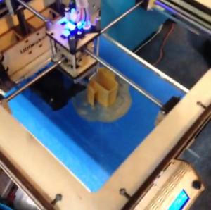 A 3D printer at work
