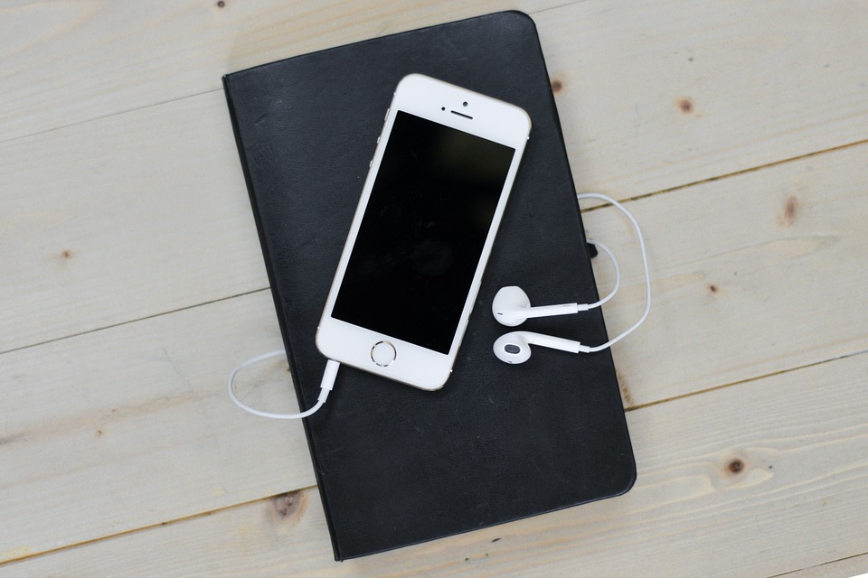 Favourite apps - A phone and headphones on top of a notebook