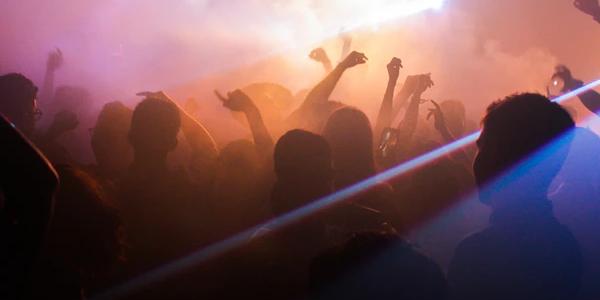 People dancing inside a nightclub during welcome week