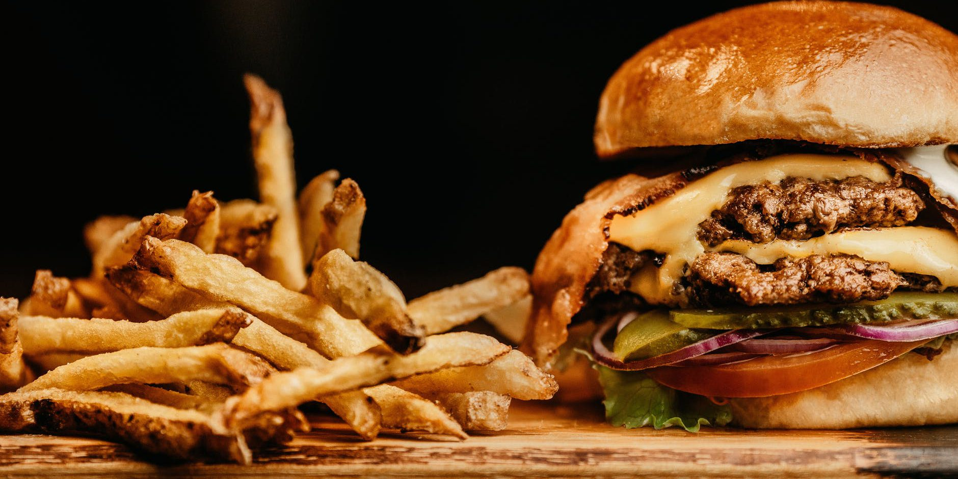 Close up photo of a Veggie style burger and fries.
