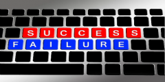 success and failure highlighted on a computer keyboard