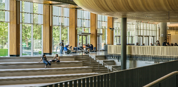 students sat on stairs at university