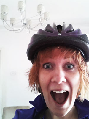 My lovely £8 black and purple bike helmet. Sure to keep my head in tact!