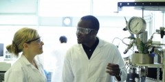 Two chemistry students researching carbon capture in laboratory