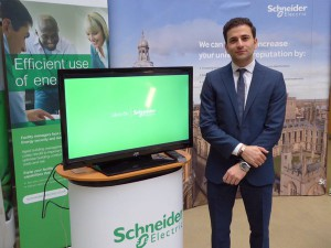 Majid Zeighami with Schneider Electric promotional display