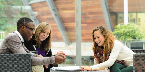 Undergraduate students in conversation in The Exchange Building, Jubilee Campus