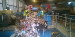Wastecycle staff hand sorting waste