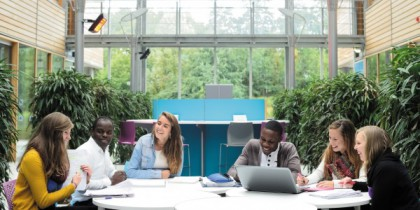 Undergraduate and postgraduate students studying in the Computer Science atrium, Jubilee campus