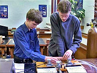 A Blind student measuring the speed fo sound with his lab assistant