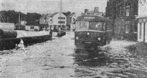 A bus drives through the flood water along South Beach Street in January 1974.
