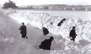 Photograph of workmen clearing snow from Goathill Road, Stornoway in order to allow milk supplies to be transported from Goathill Farm to the town. The winter of 1955 was the worst between 1947-6 and 1962-3.
