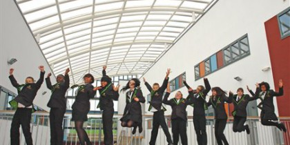 School children jumping