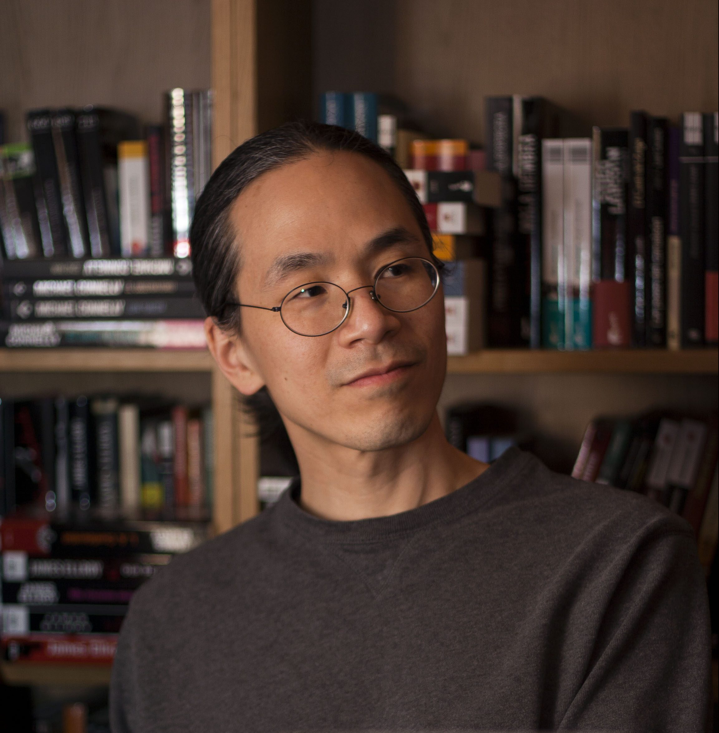 A photograph of author Ted Chiang.