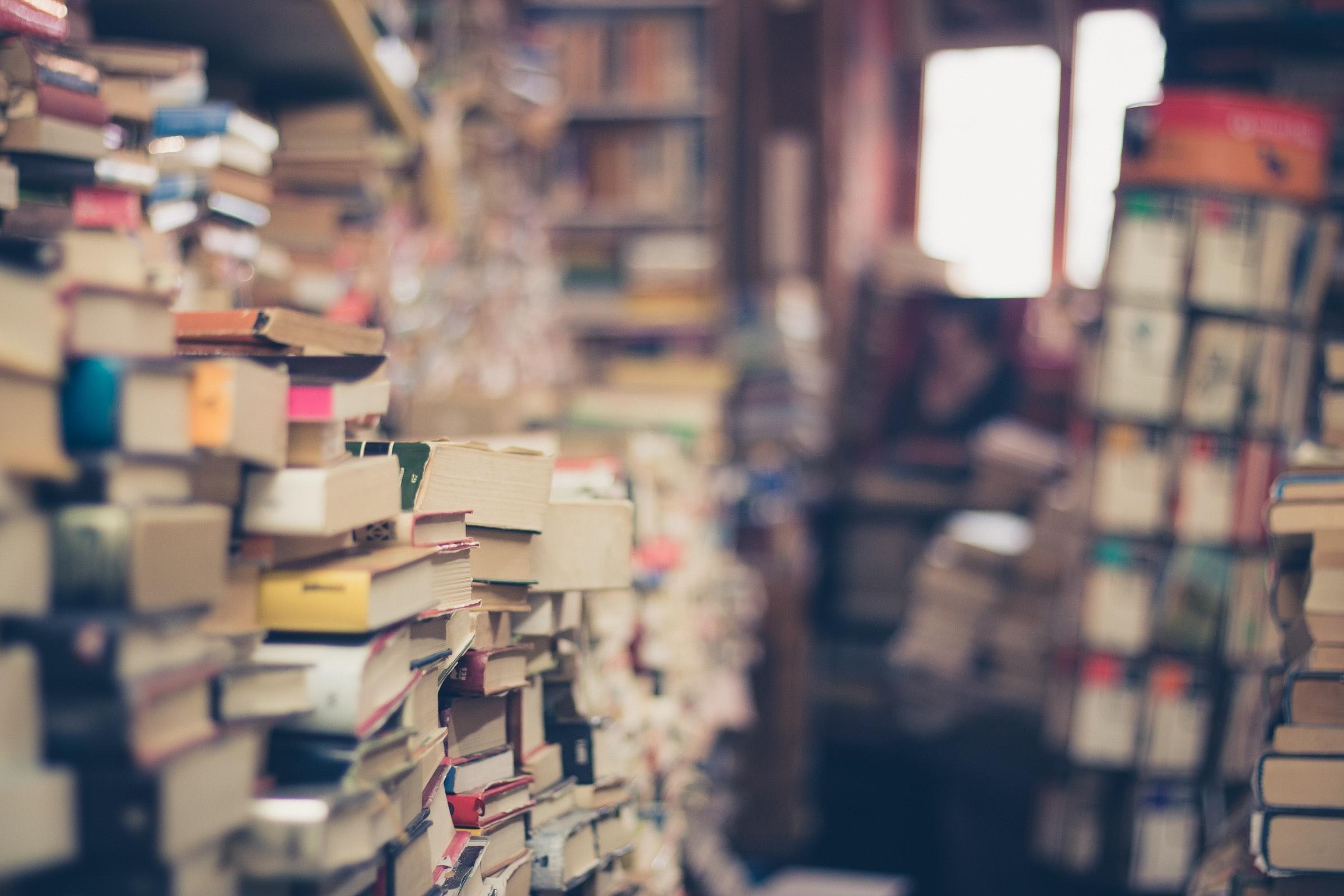 A room full of piles of books.