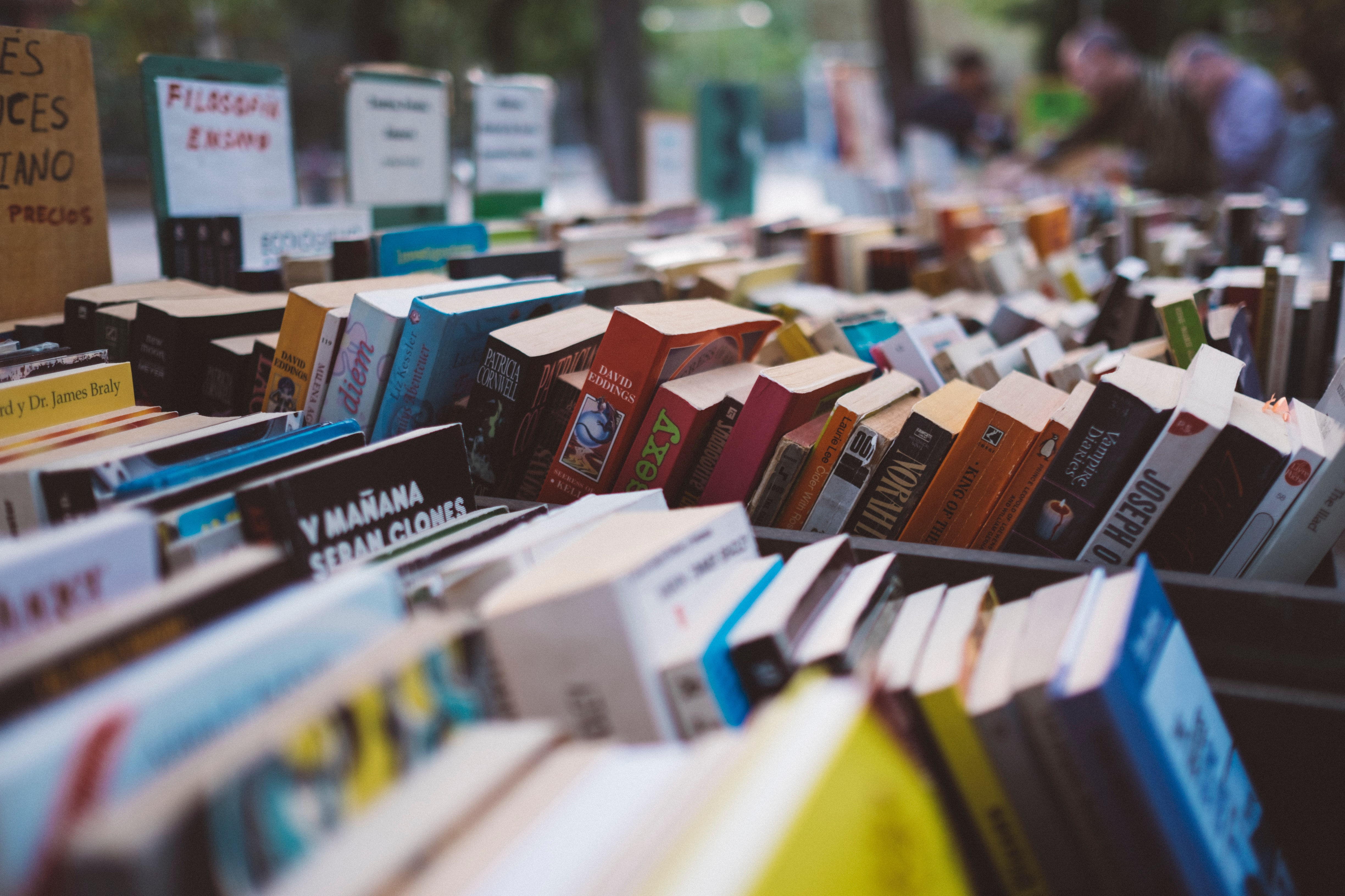Books in boxes at a book sale.